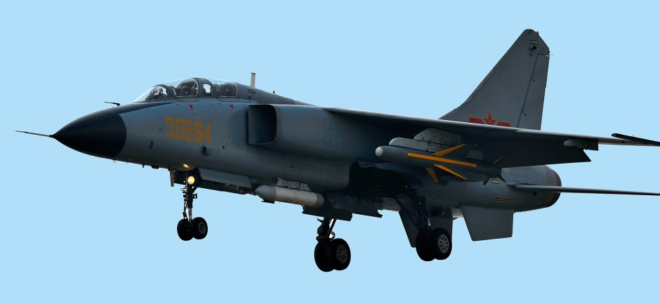 A PLAAF JH-7A fighter-bomber carrying the KD-88 missile under its wing. The targeting pod is clearly visible underneath the aircraft fuselage