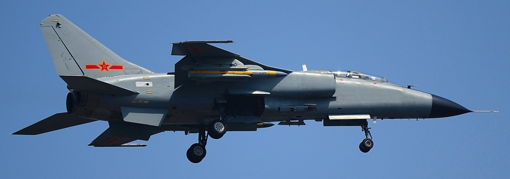 A PLAAF JH-7A fighter-bomber carrying two YJ-91 anti-radiation missiles under its wings